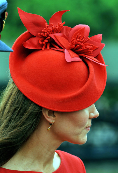 Kate Middleton Dress and Hat red representing the Red Hairy One Esau as Israel - June 2012 celebrating the Queen of England 60th Anniversary upon her Esau/Israel  United Kingdom Throne which started from 1952/1953 The Year of the Light well orchestrated from the Red Esau/Core - Cain (Jude 4 & Jude 11) counterfeit Holy Land Israel (Malachi 1:1-3)