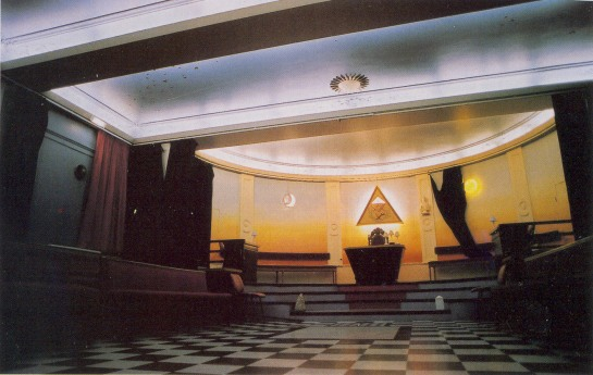 Yod symbol within a upright pyramid elevated above the Most Worshipful Master Masons Seat off Power and Authority of King Solomon's Quarries Temple (Acts 7:46-49)