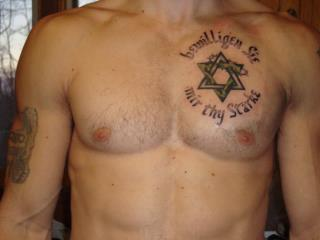 notice over the heart area is the Tattoo of Microprosposos/Macroprosposos refer to Genesis 6:4-5....