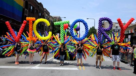 CHICAGO --- People celebrate during the 46th Annual Chicago Pride Parade, Sunday, June 28, 2015, in Chicago. A large turnout was expected for gay pride parades across the U.S. following the landmark Supreme Court ruling that said gay couples can marry anywhere in the country. (AP Photo/Nam Y. Huh)